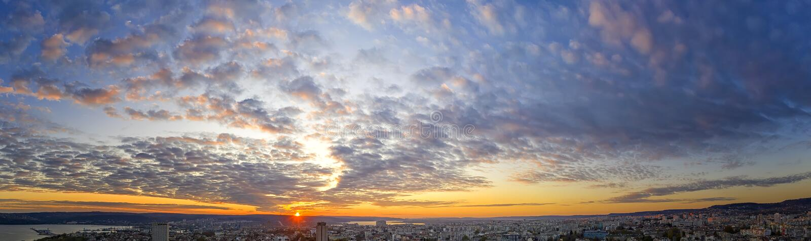 Amazing scenic view of the colorful sky with the sun over the city. Panoramic view from a drone stock photos