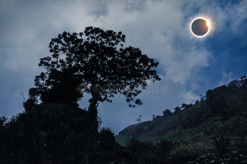Scientific natural phenomenon. Total solar eclipse glowing on sk. Amazing scientific natural phenomenon. The Moon covering the Sun. Total solar eclipse with stock photo