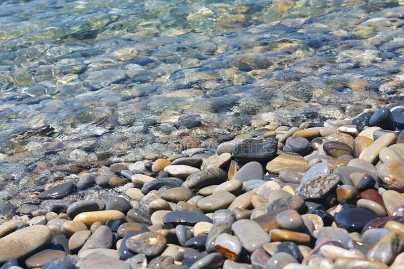 Amazing sea pebbles under water on beach royalty free stock photo