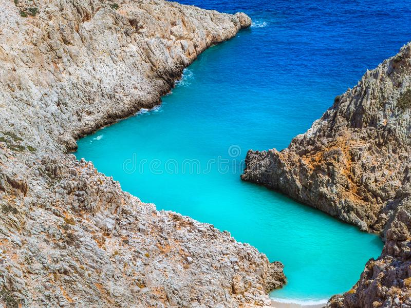Amazing secluded beach in between zig - zag cliffs - beautiful shades of blue sea - tropical paradise royalty free stock photos