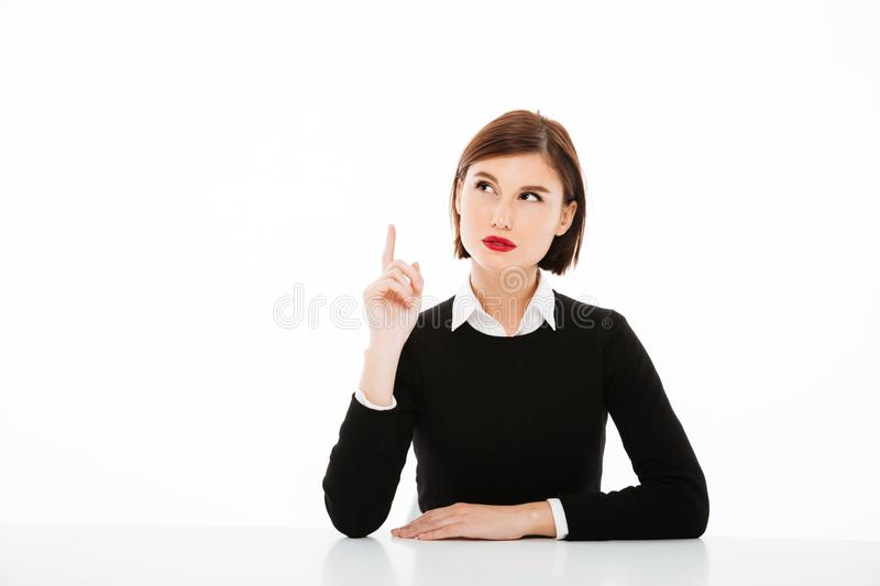 Amazing serious young business woman pointing. royalty free stock photo