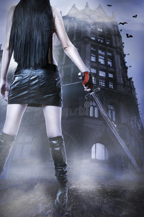 Amazing woman. Halloween. Fashion fantasy portrait of unknown amazing woman with medieval sword stay about old house by rain. Halloween style