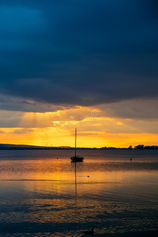 Amazing summer evening landscape with group of drifting yachts on a lake royalty free stock image