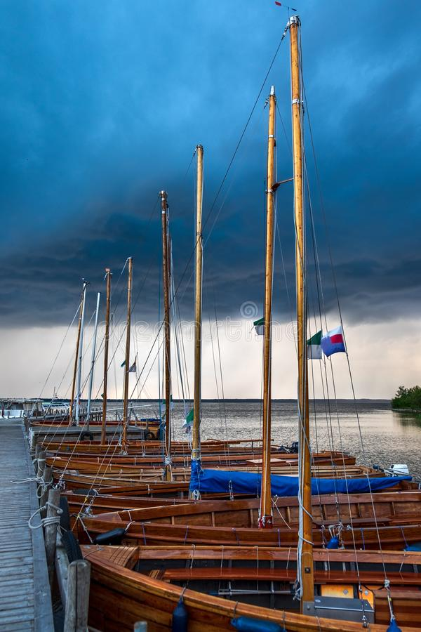 Amazing summer evening landscape with group of drifting yachts on a lake stock photography