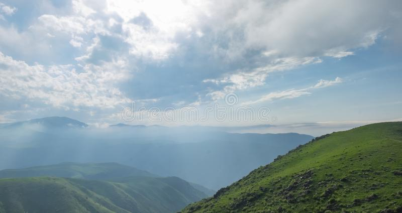 Amazing summer landscape, view to the green hills and beautiful sky royalty free stock image