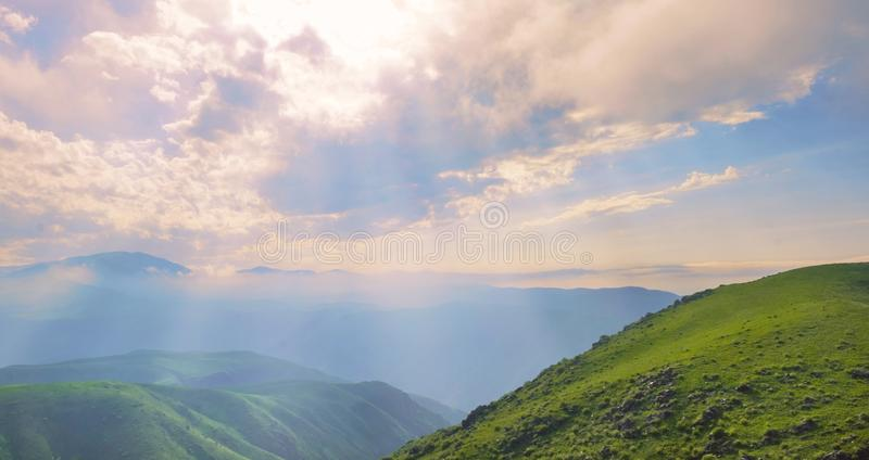 Amazing summer landscape, view to the green hills and beautiful sky royalty free stock photo