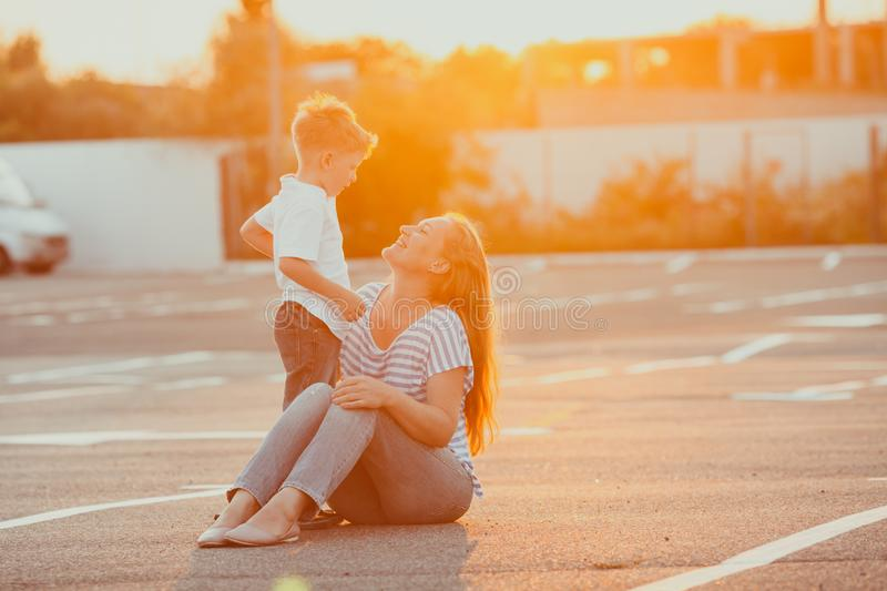 Amazing summer portrait of happy mother and son stock photo