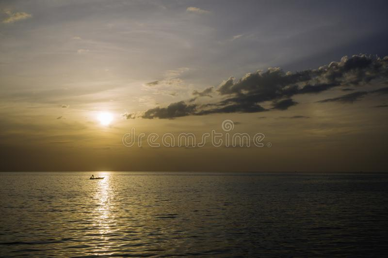 Amazing summer sunset view on the beach. Beautiful blazing sunset landscape at black sea and orange sky above it with awesome sun royalty free stock photo