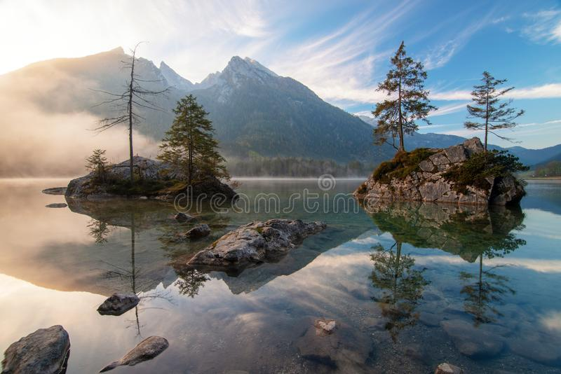 Amazing sunrise on Hintersee lake at autumn morning stock photos