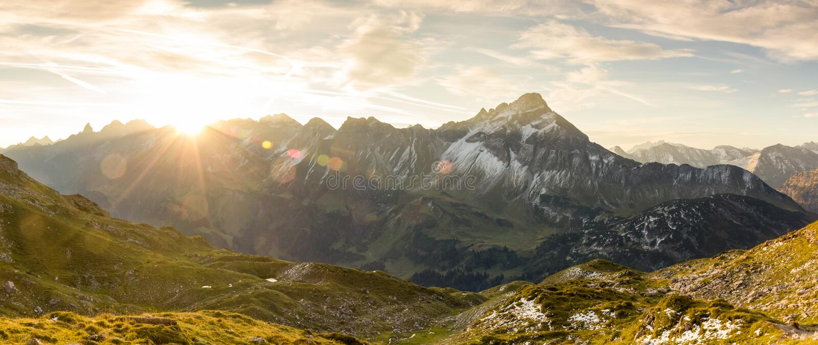 Amazing sunrise in the mountains. Nice lens flares and sunbeams stock photography
