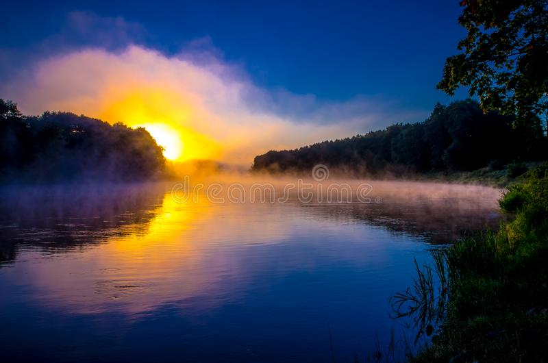 Cold sunrise near misty river stock photo