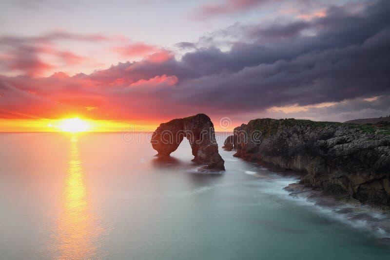 Amazing sunrise over Castro de las Gaviotas. Asturias, Spain stock images