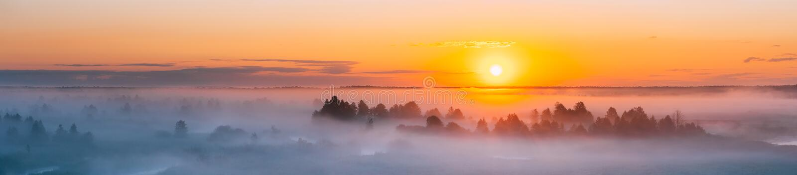 Amazing Sunrise Over Misty Landscape. Scenic View Of Foggy Morning. Sky With Rising Sun Above Misty Forest. Middle Summer Nature Of Europe. Panorama, Panoramic stock images
