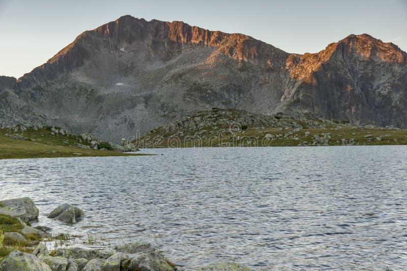 Amazing Sunrise over Tevno Lake and Kamenitsa peak, Pirin Mountain stock photos