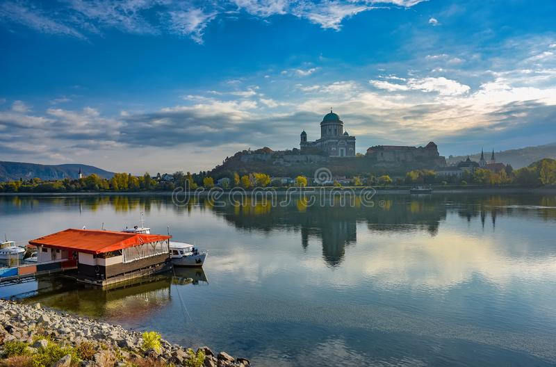 Amazing sunrise view over Danube river, Esztergom, Hungary. Amazing sunrise view over Danube river. Pier and boats on Slovak side and autumn yellow trees royalty free stock photos