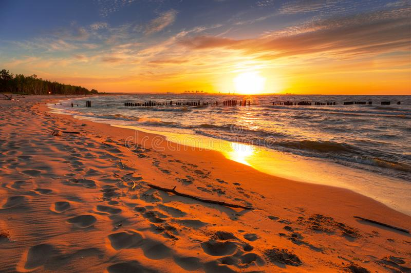 Amazing sunset at Baltic sea beach. In Poland royalty free stock photo