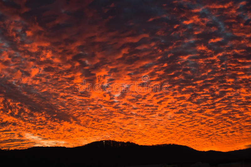 Amazing sunset with big orange fire in the sky on a road royalty free stock photos