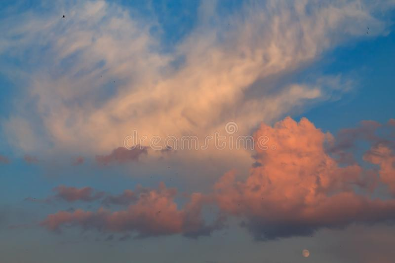 Amazing sunset clouds with blue sky stock photo