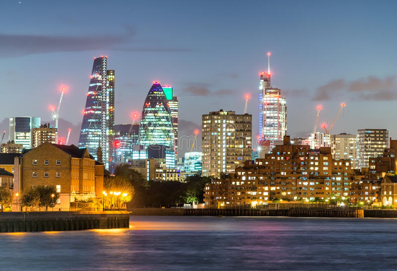 Amazing sunset colors of City of London skyline from Canary Wharf, UK stock photos