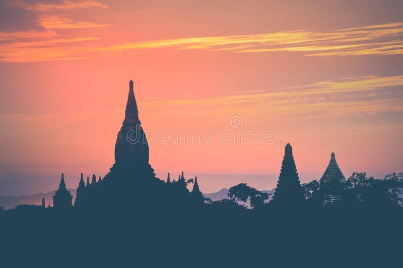 Amazing sunset colors and silhouettes of ancient Buddhist Temples at Bagan Kingdom, Myanmar Burma. Travel landscape and stock photography