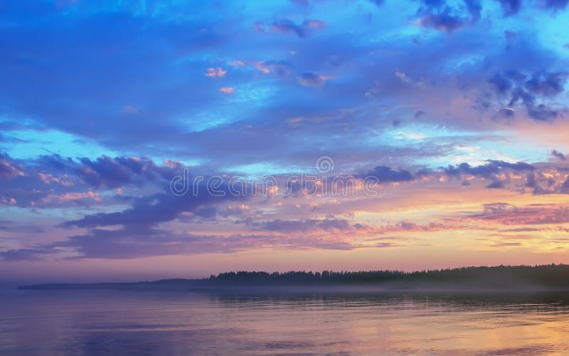 Amazing Sunset Over The Forested Shore Of The Lake stock images