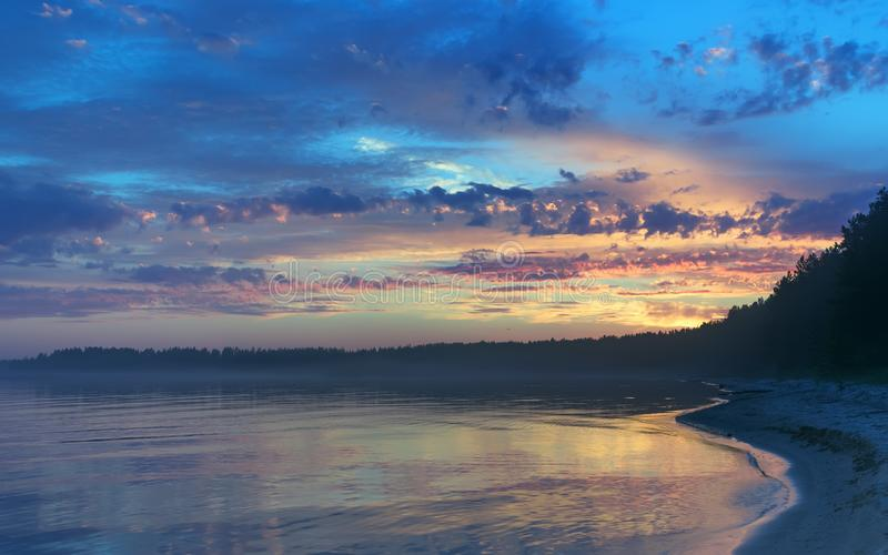 Amazing Sunset Over The Forested Shore Of The Northern Lake royalty free stock photography