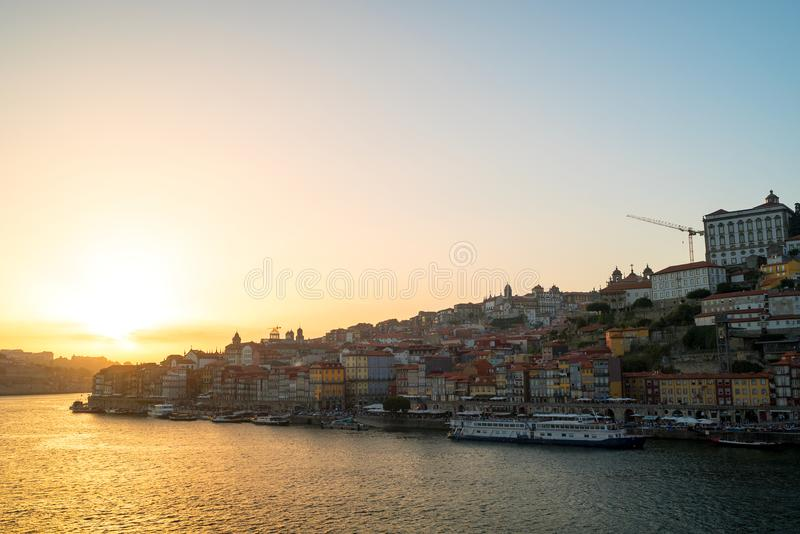 Amazing sunset over the Porto old town skyline on the Douro River, Portugal. stock photos