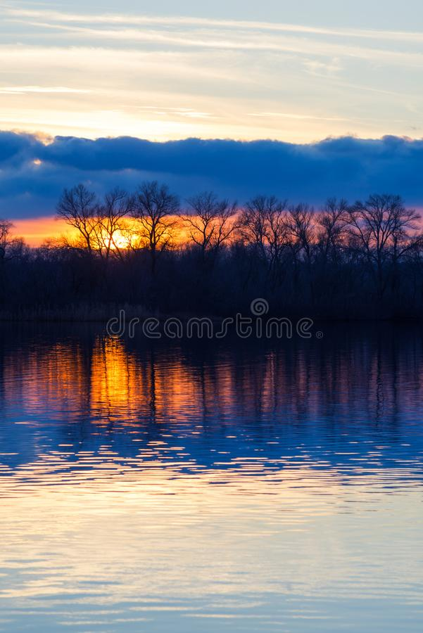 Amazing sunset over the river in a purple tones stock images
