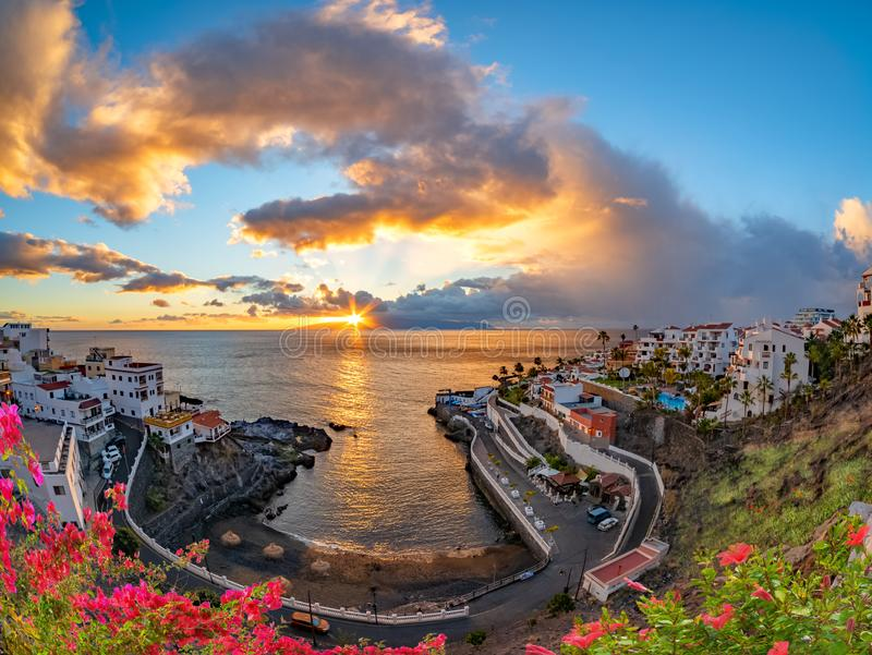 Amazing sunset in Puerto de Santiago. Sunset in Puerto de Santiago town in summer season, Tenerife of Canary island, Spain royalty free stock photo
