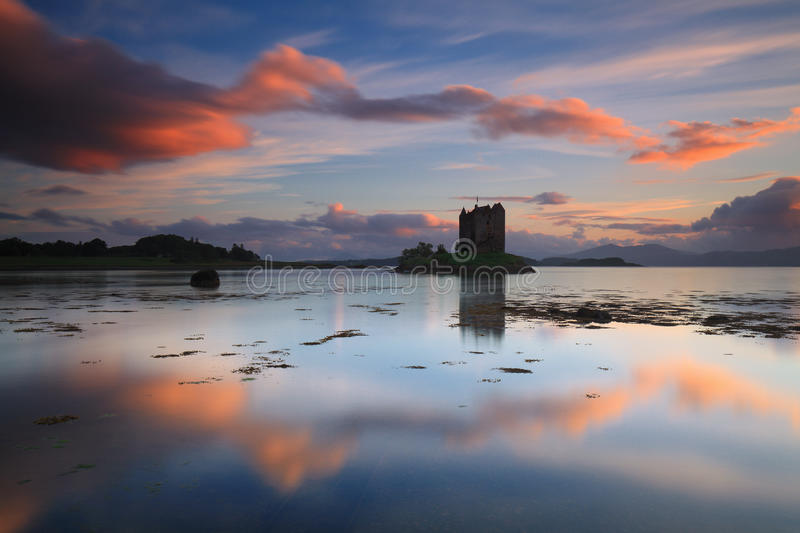 Amazing sunset with reflections at Castle Stalker. (Scotland, UK royalty free stock images