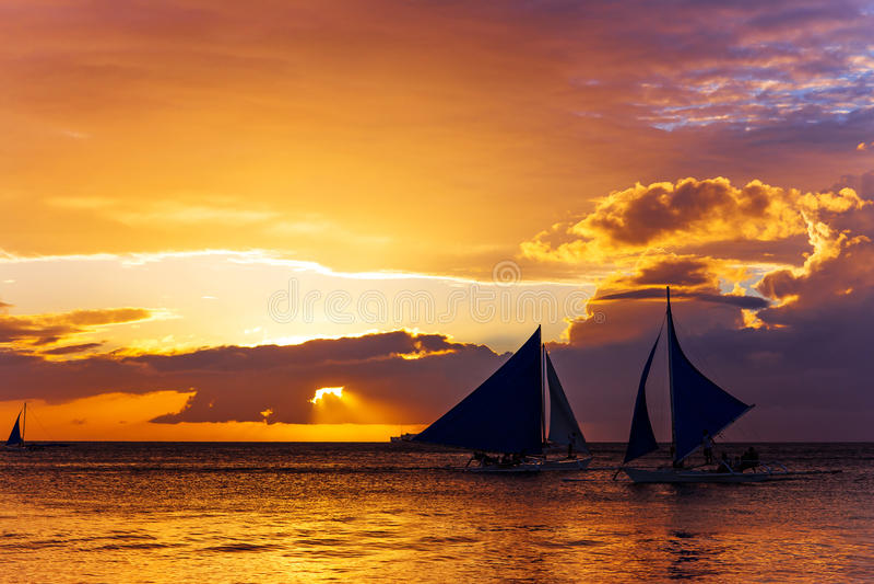 Amazing sunset at sea. Sailboat stock image