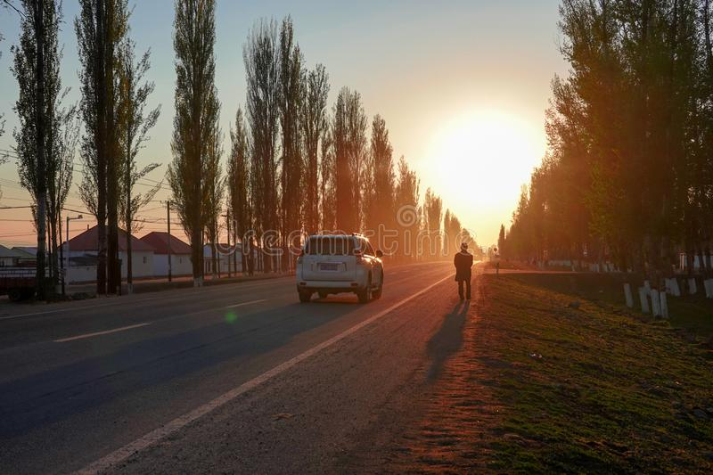 Amazing Sunset over the road with cars in spring stock photo