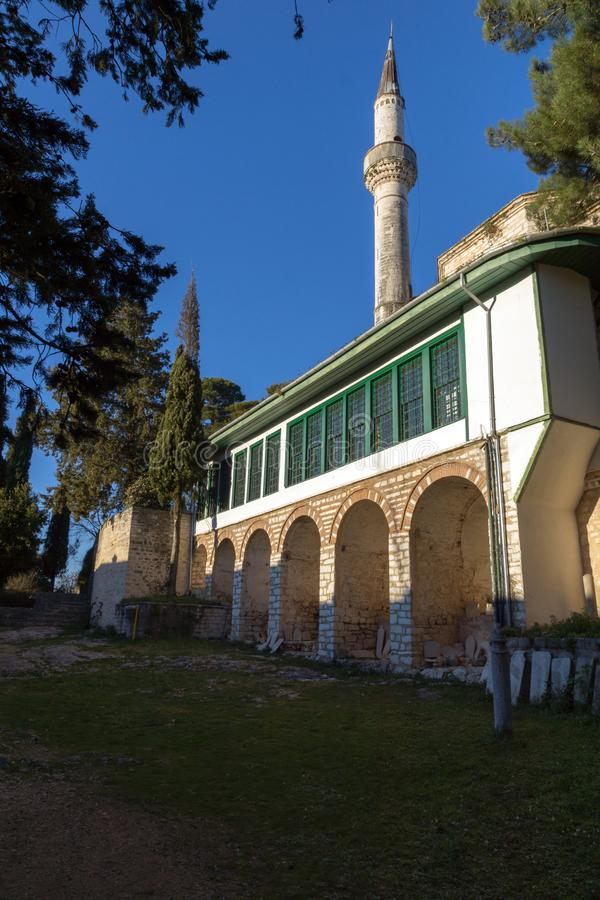 Amazing Sunset view of Aslan Pasha Mosque in castle of city of Ioannina, Epirus, Greece. IOANNINA, GREECE - DECEMBER 27, 2014: Amazing Sunset view of Aslan Pasha stock photos