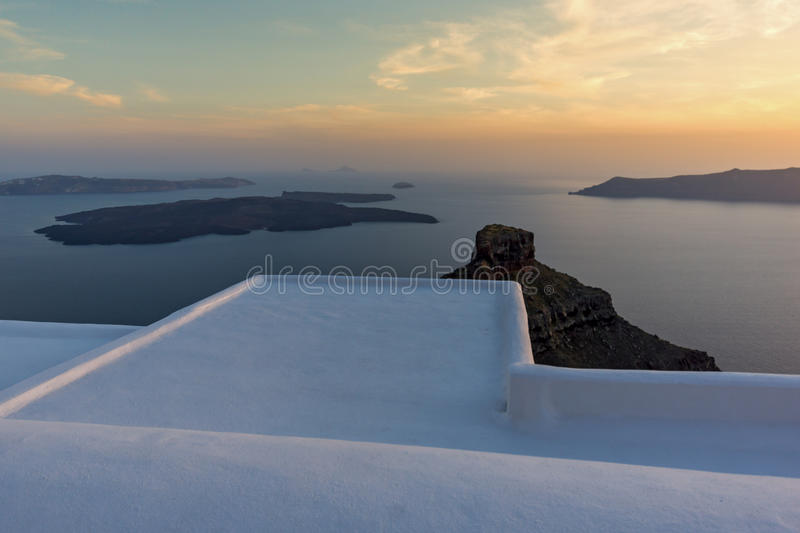 Amazing sunset view from town of Imerovigli to volcano, Santorini island, Thira, Greece royalty free stock image