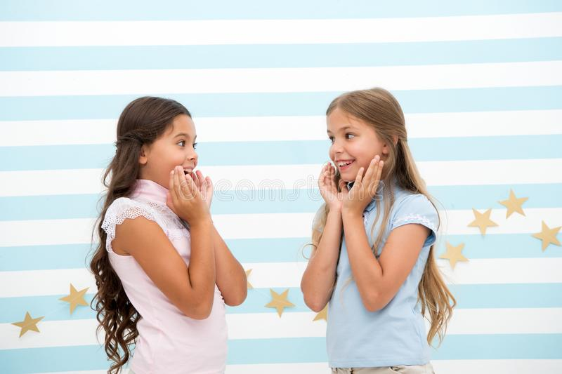 Amazing surprising news. Girls excited expression. Girls kids just heard amazing news. Surprised children excited about. Rumors. Secret little lies or gossips royalty free stock photography