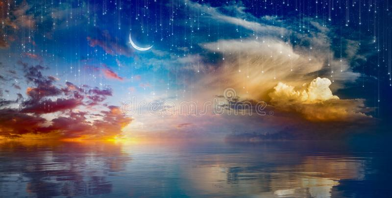 Amazing surreal background - crescent moon rising above sea stock photography