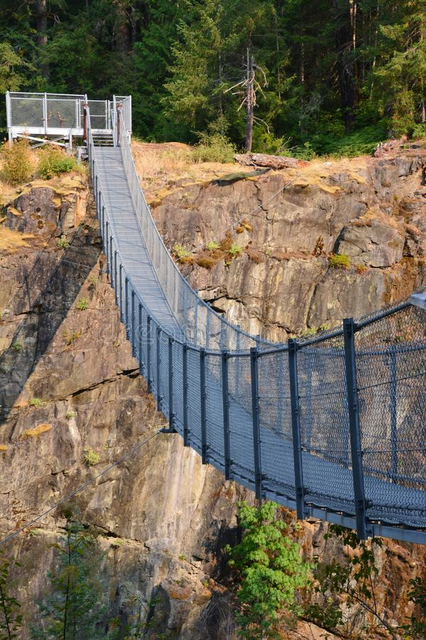 Elk falls provincial park Campbell River. Amazing suspension bridge in Elk Falls provincial park Campbell River Vancouver island royalty free stock images