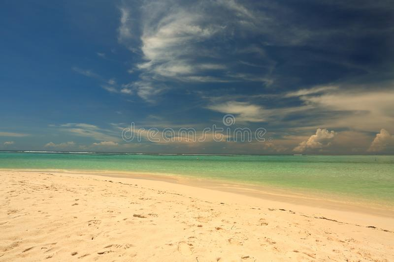 Amazing tropical landscape view. White sand beach , turquoise water and blue sky with white clouds. Horizon line. Indian. Amazing tropical landscape view. White stock photography