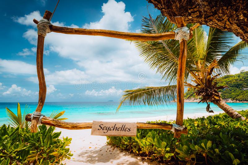 Amazing tropical scene with bamboo frame on the white sand beach against turquoise sea. Vacation in paradise. mahe royalty free stock photos
