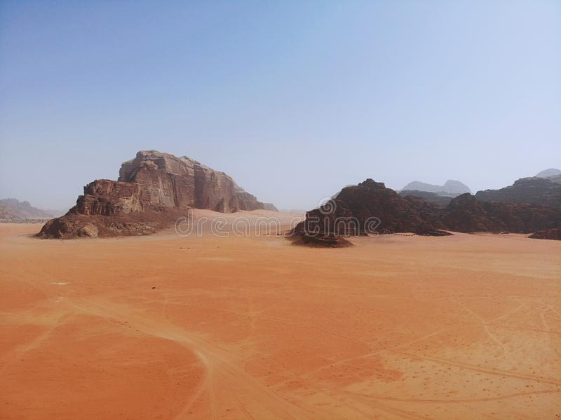 Amazing view from above on the huge, red, hot and very beautiful desert Wadi Rum. Kingdom of Jordan , Arab country in Western Asia royalty free stock images