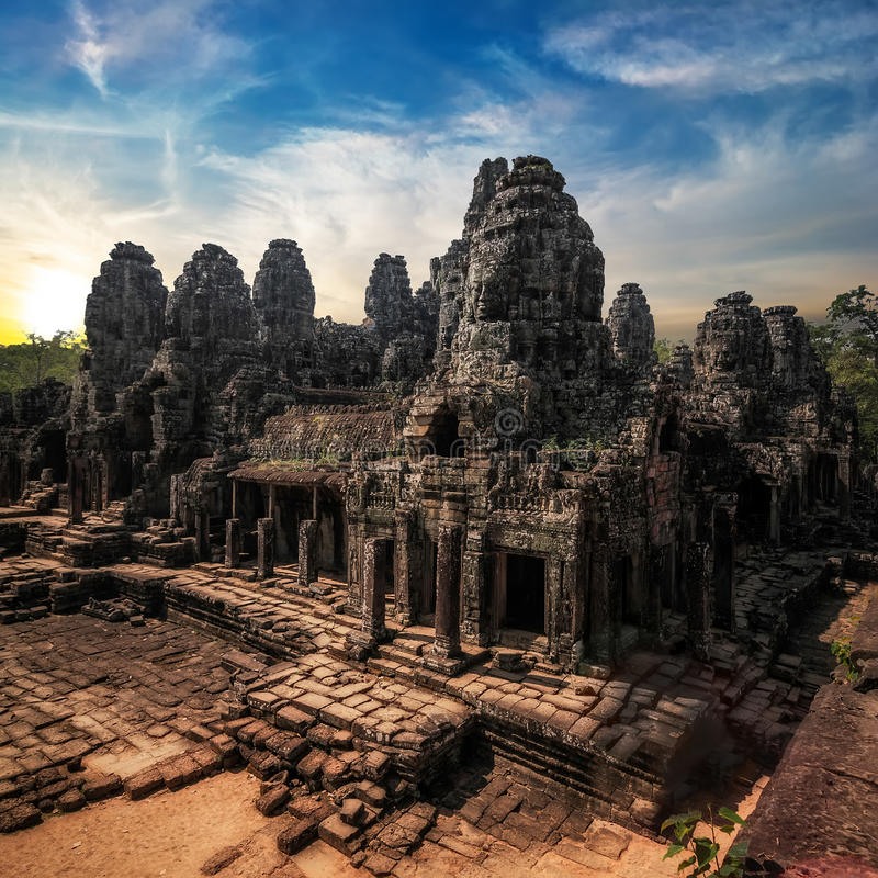 Amazing view of Bayon temple at sunset. Angkor Wat, Cambodia. Ancient Khmer architecture. Amazing view of Bayon temple at sunset. Angkor Wat complex, Siem Reap stock photo