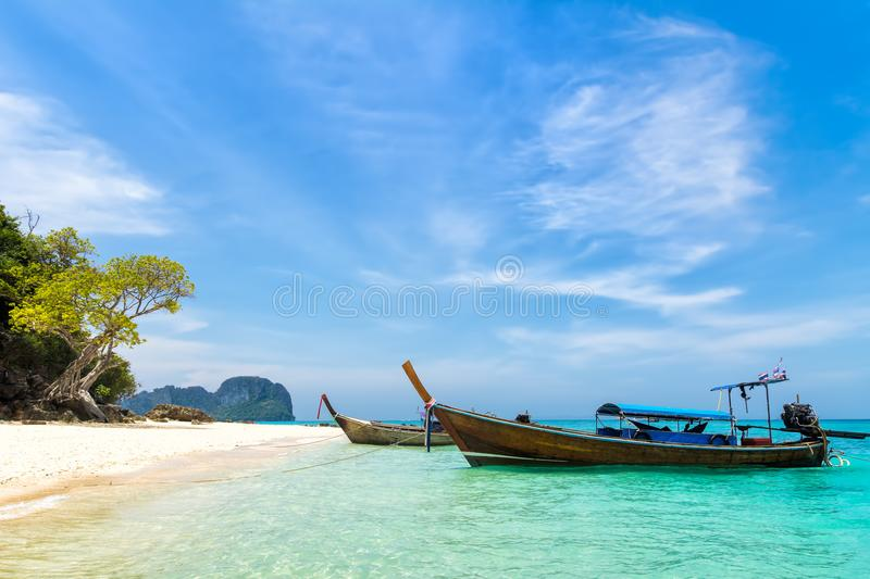 Amazing view of beautiful beach with traditional thailand longtale boat. Location: Bamboo royalty free stock images