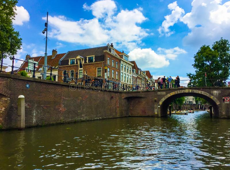 Amazing view of beautiful buildings, bicycles, a bridge with group of people and tourist stock photos