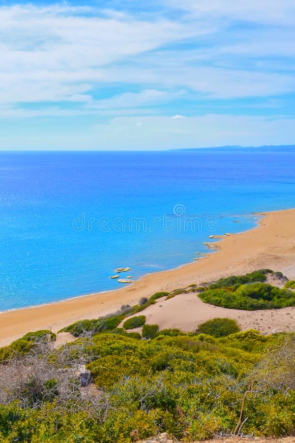 Amazing view of beautiful Golden Beach in Karpas Peninsula, Northern Cyprus taken on a sunny day from the adjacent hills. The remote sandy beach is a popular royalty free stock images