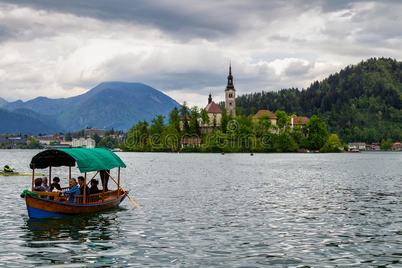 Amazing View On Bled Lake, Island,Church And Castle With Mountain Range (Stol, Vrtaca, Begunjscica) In The royalty free stock photography