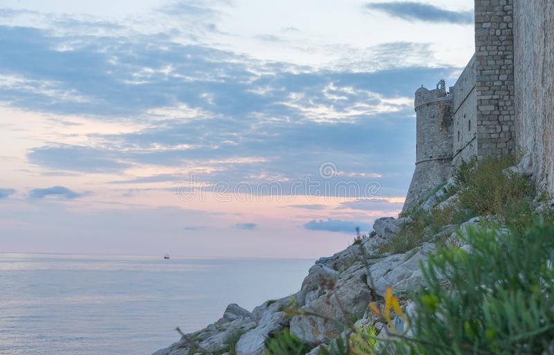 Amazing view of the castle on top of the mountain in Dubrovnik Croatia. Guard post above walls of the old town of Dubrovnik. Sunset adriatic sea sightseeing stock image