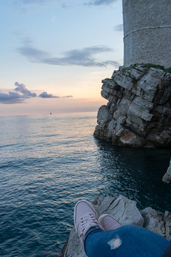 Amazing view of the castle on top of the mountain in Dubrovnik Croatia. Guard post above walls of the old town of Dubrovnik. Sunset adriatic sea sightseeing royalty free stock photography