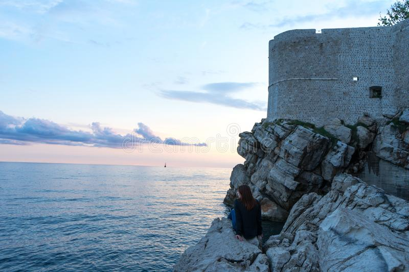 Amazing view of the castle on top of the mountain in Dubrovnik Croatia. Guard post above walls of the old town of Dubrovnik. Sunset adriatic sea sightseeing royalty free stock photo