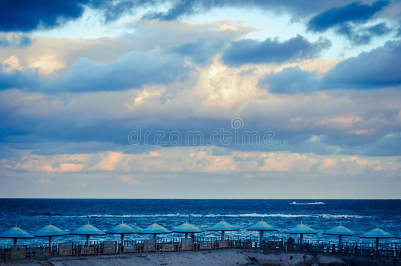 Sunrise on winter day Alex. Amazing view cloudy winter sky with sunrise on Alexandria Egypt royalty free stock photos