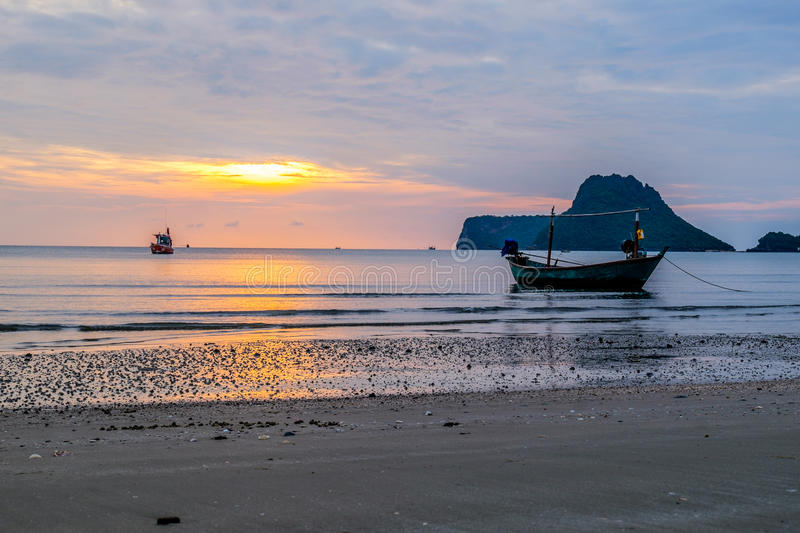 Amazing view of fishing boat at sunset stock photography